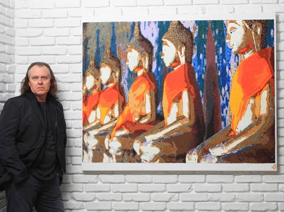 Kevin Page, NFT artist, displays one of his earlier oil on canvas works of pointillism.
